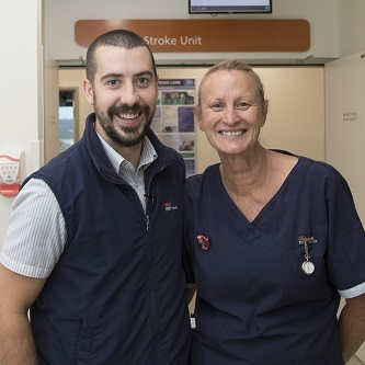 male and female nurse smiling