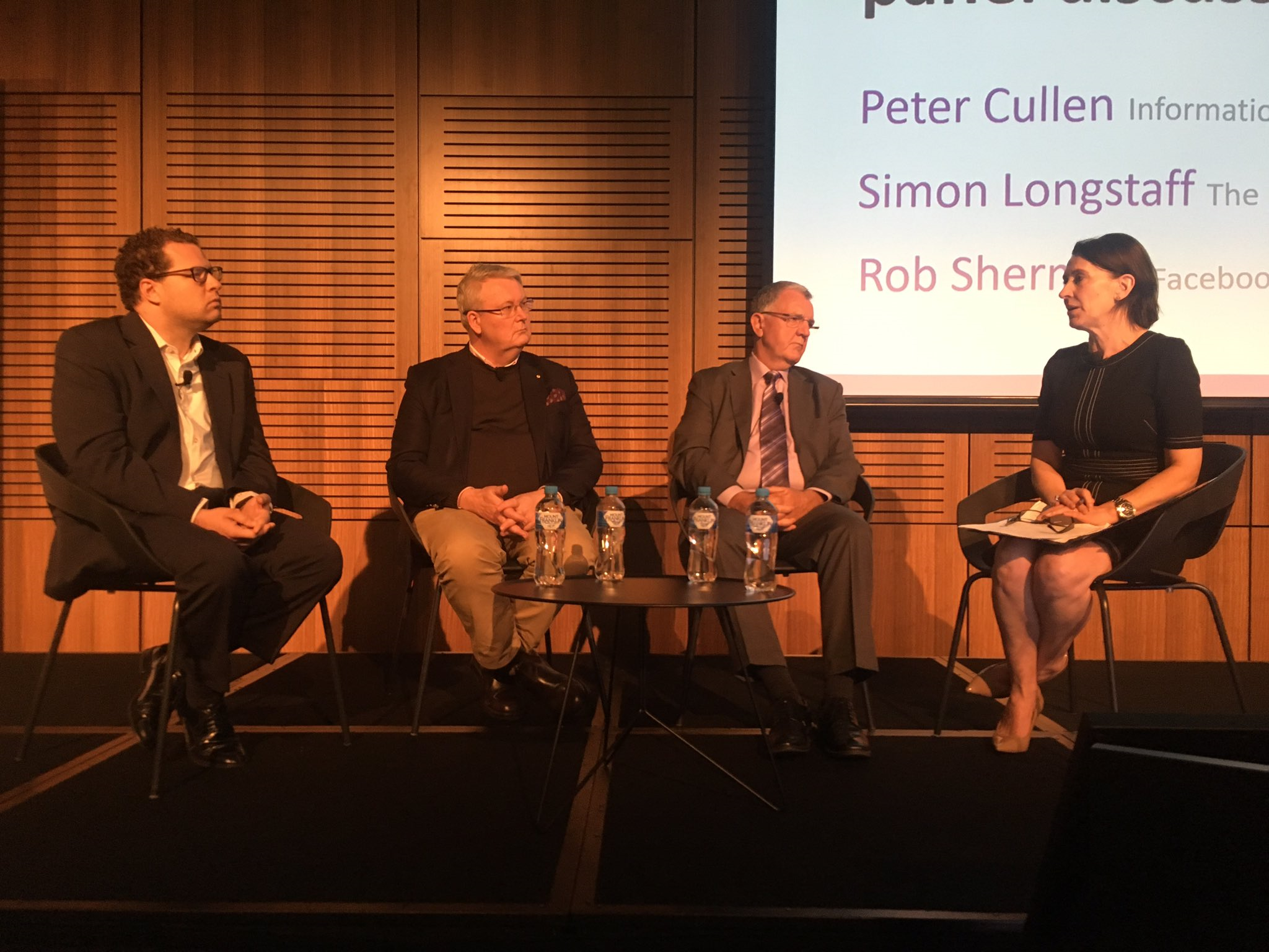 Virginia Trioli, Peter Cullen, Simon Longstaff, and Rob Sherman on a panel discussion at the Data + Privacy Asia Pacific conference