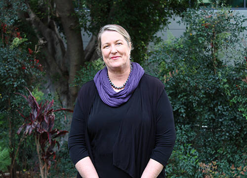 Professor Vicki Clifton standing with a tree behind her